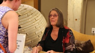 'Losing Tim' author Janet Burroway signs a book for a reader at the Loft Literary Center, Aug. 15, 2014. Kevin Featherly's mini-documentary on the book debuts Oct. 6. Photo: Kevin Featherly